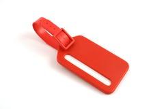 Etiqueta plástica vermelha da bagagem fotografia de stock royalty free