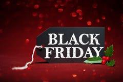 Etiqueta preta da venda de sexta-feira no fundo vermelho imagem de stock royalty free