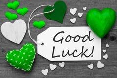 A etiqueta preto e branco com corações verdes, Text a boa sorte imagens de stock royalty free