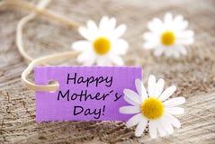 Etiqueta púrpura con día de madres feliz Fotografía de archivo