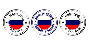 Etiqueta redonda hecha en Rusia con la bandera Fotos de archivo libres de regalías