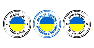 Etiqueta redonda hecha en Ucrania con la bandera Imágenes de archivo libres de regalías