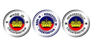 Etiqueta redonda y x22; Hecho en Liechtenstein& x22; con la bandera Fotografía de archivo