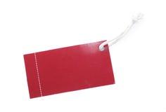 Etiqueta roja con la cuerda de rosca blanca del algodón Fotografía de archivo