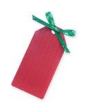 Etiqueta roja del regalo con el arqueamiento chispeante verde Imagenes de archivo