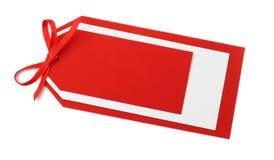 Etiqueta roja en blanco con el arqueamiento Foto de archivo