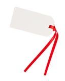 Etiqueta vazia do presente com fita vermelha fotografia de stock royalty free