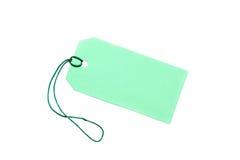 Etiqueta verde en blanco atada con la cadena en blanco. fotografía de archivo libre de regalías