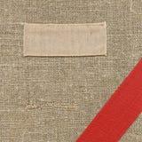 Etiqueta vieja de la materia textil Fotos de archivo libres de regalías