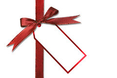 Etiqueta y arqueamiento del regalo de día de fiesta Imagenes de archivo