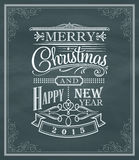Etiqueta y marco del vintage del Año Nuevo de la Navidad en una pizarra Fotos de archivo libres de regalías