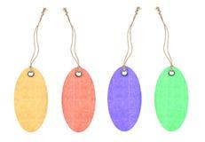Etiquetas coloridas con los remaches del metal aislados en blanco Foto de archivo libre de regalías
