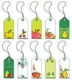 Etiquetas coloridas de la fruta. Fotografía de archivo