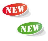 Etiquetas coloridas ovais com as palavras NOVAS Fotos de Stock Royalty Free