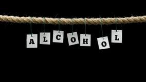Etiquetas con las letras negras que forman el alcohol de la palabra Imagenes de archivo