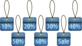 Etiquetas de compra feitas das calças de brim ilustração do vetor
