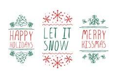 Etiquetas de la Navidad con el texto en el fondo blanco Imagen de archivo libre de regalías