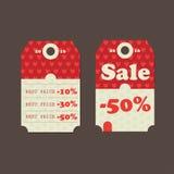 Etiquetas de la venta con los mensajes de la venta Imagenes de archivo