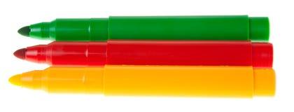Etiquetas de plástico coloreadas brillantes en el fondo blanco Foto de archivo libre de regalías
