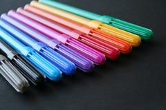 Etiquetas de plástico coloreadas fijadas Fotografía de archivo