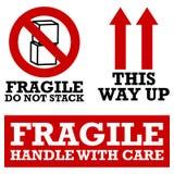Etiquetas de transporte frágeis Fotos de Stock Royalty Free