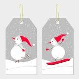 Etiquetas del Año Nuevo con los muñecos de nieve Imagen de archivo
