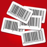 Etiquetas del código de barras en fondo rojo Fotografía de archivo libre de regalías