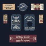 Etiquetas del dril de algodón en fondo oscuro ilustración del vector