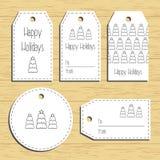Etiquetas del regalo de la Navidad listo para utilizar Saludo de la Navidad Fondo de madera Vector Fotos de archivo libres de regalías