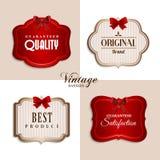 Etiquetas del vintage del vector con las cintas rojas Imágenes de archivo libres de regalías