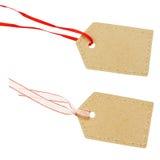 Etiquetas do cartão em fitas vermelhas e brancas Foto de Stock