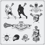 Etiquetas do clube da lacrosse, emblemas, elementos do projeto e silhuetas dos jogadores Fotografia de Stock