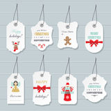 Etiquetas do Natal e do ano novo feliz e moldes dos crachás ajustados Imagens de Stock