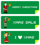 Etiquetas do Xmas com caráteres do pixel Foto de Stock