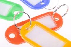Etiquetas dominantes en blanco coloridas Fotografía de archivo libre de regalías
