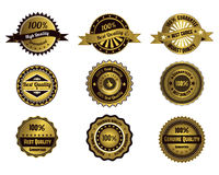 Etiquetas douradas da qualidade Fotos de Stock Royalty Free
