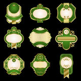 Etiquetas douradas do luxo no fundo preto Imagem de Stock