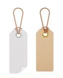 Etiquetas en blanco del blanco y de la cartulina aisladas en el fondo blanco Imagen de archivo libre de regalías