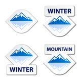 Etiquetas engomadas azules de la montaña del invierno Imagenes de archivo