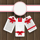Etiquetas engomadas blancas del precio de la Navidad del emblema de madera Foto de archivo libre de regalías