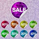 Etiquetas engomadas brillantes de la venta con la iluminación del triángulo dentro Foto de archivo