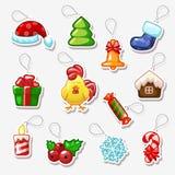 Etiquetas engomadas de la Navidad y del Año Nuevo, símbolos del día de fiesta Foto de archivo libre de regalías