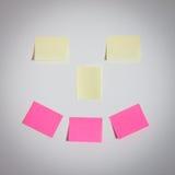 Etiquetas engomadas de la sonrisa en la pared Fotografía de archivo libre de regalías