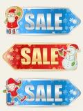 Etiquetas engomadas de la venta de la Navidad con los caracteres de Navidad Fotos de archivo