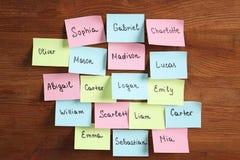 Etiquetas engomadas de papel con nombres diferentes Imágenes de archivo libres de regalías