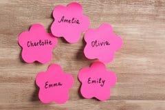 Etiquetas engomadas de papel con nombres diferentes Fotografía de archivo libre de regalías