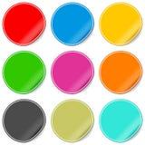 Etiquetas engomadas en blanco coloridas fijadas Imagen de archivo libre de regalías