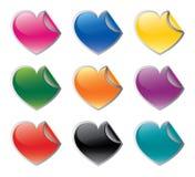 Etiquetas engomadas en forma de corazón coloridas fijadas Fotografía de archivo libre de regalías