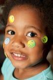 ¡Etiquetas engomadas en mi cara! Imagen de archivo libre de regalías