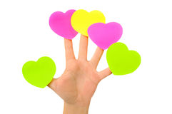 Etiquetas engomadas multicoloras en la mano femenina. ISO Fotos de archivo libres de regalías